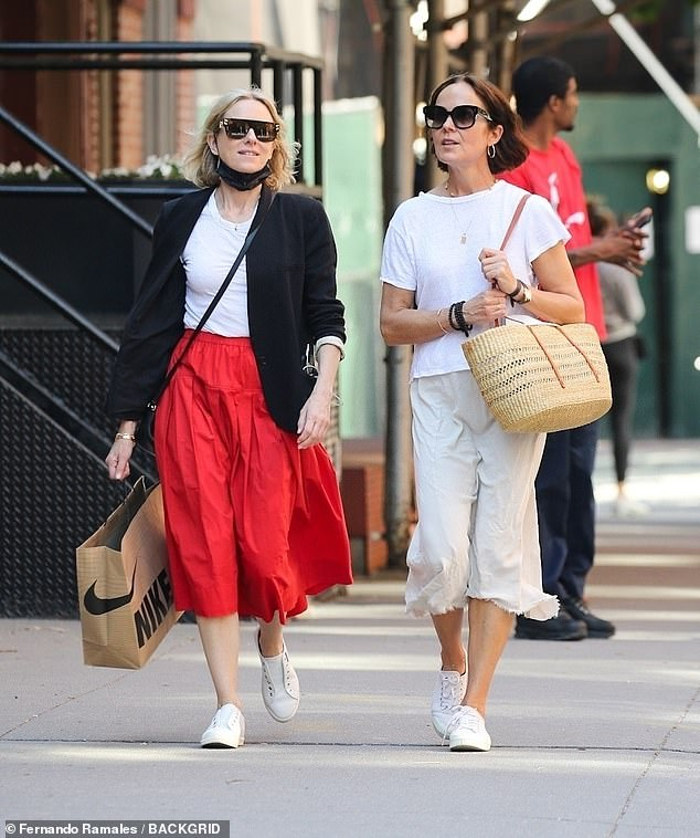 Friendly: Meanwhile, her pal, Rebecca Rigg, sported a white t-shirt, matching FRANKiE4 sneakers and a straw tote bag