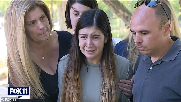 Aiden's distraught family are begging for justice with Aiden's older sister, Alexis Cloonan, pictured center, describing him and someone who was full of 'love, joy and laughter'