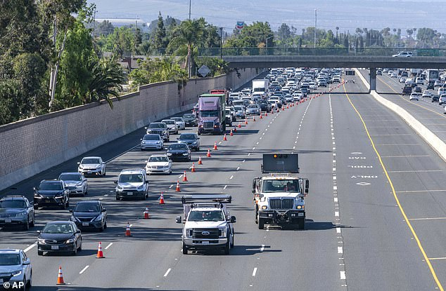 Traffic traveling northbound on the 55 freeway was diverted to the westbound 22 freeway as police investigators walked the freeway looking for evidence following the shooting