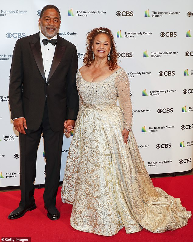 Cute couple:Debbie was accompanied by her husband Norm Nixon in a classic tux