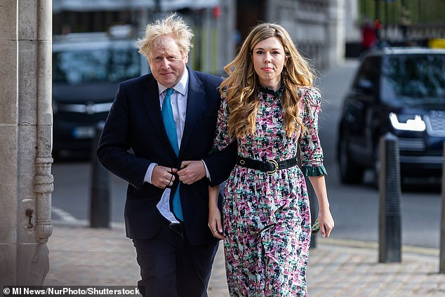 The lavish refurbishment of 11 Downing Street, which featured gold wallpaper by interior designer Lytle, reportedly cost a six-figure sum. Pictured: Mr Johnson and Ms Symonds