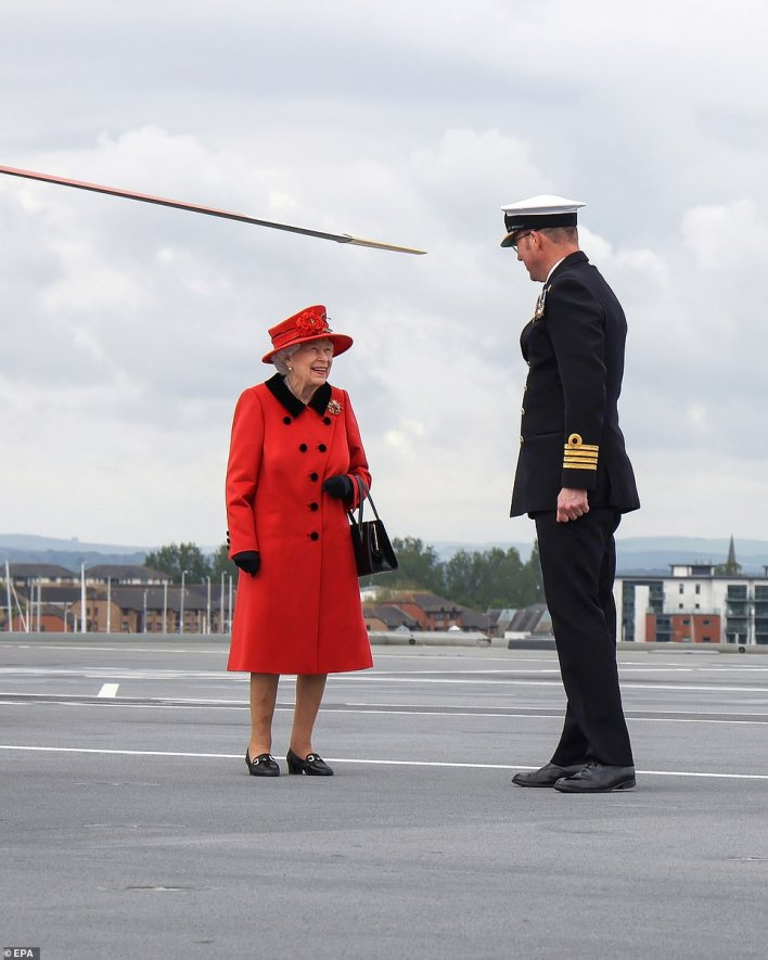 Captain Essenhigh (pictured) said it was a 'great privilege to host the Queen' on the HMS Queen Elizabeth as well as saying that having her 'wish us well as we set off on a seven-month deployment is something incredibly special'