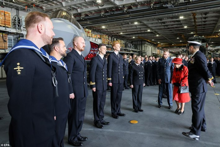 Engineering technician marine engineering (ETME) Billie Matthews, 22, from County Durham, who was one of those who met the Queen (pictured greeting members of aviation assets), said the Queen was 'very chatty, very smiley'