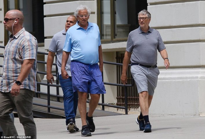 Bill Gates sported black dress socks with sneakers and shorts as he stepped out in Manhattan on Saturday, heading to luncheon with a friend and bodyguards. It is the first time he ahs been seen since news of his divorce