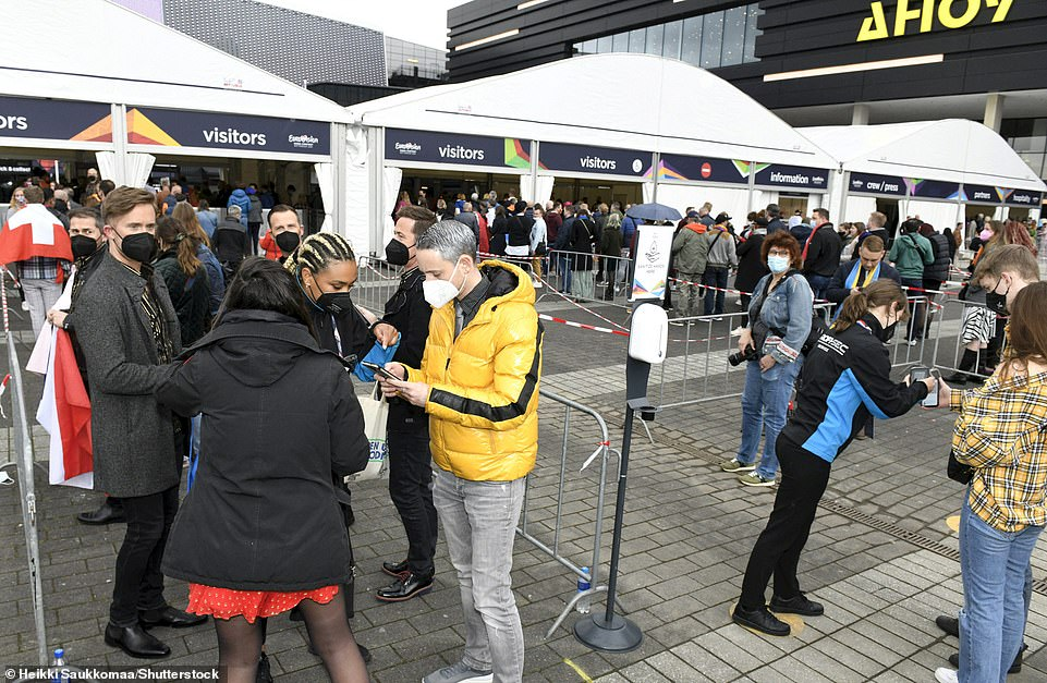 Fans wait in queues and have their tickets checked as they arrive to the Eurovision song contest in the Netherlands