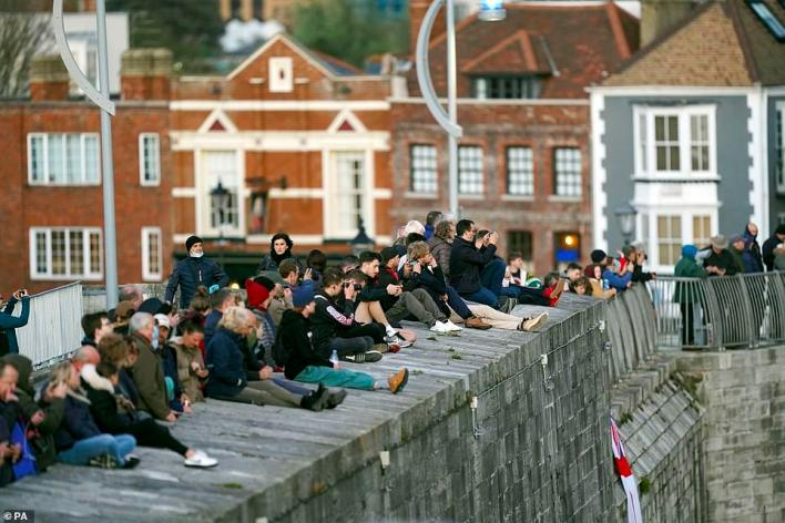 Hundreds of people lined the harbour walls to wave off the £3 billion warship as it set off from Portsmouth Naval Base