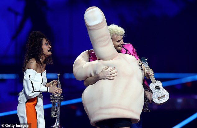 During his performance, Germany's Jendrick Sigwart was joined by a back-up dancer donning a strange middle finger outfit