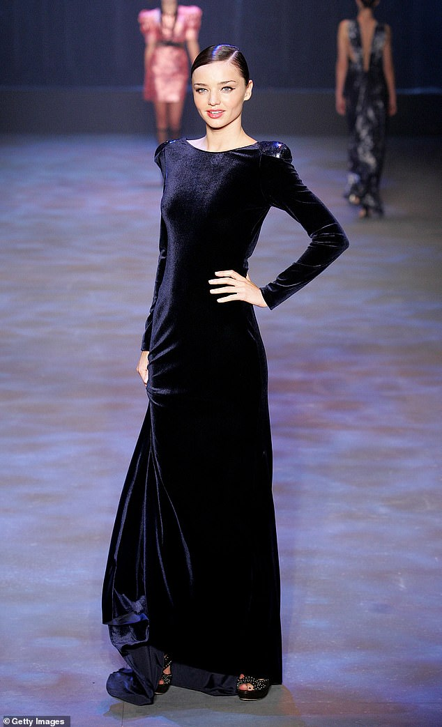 Famous threads: Her designs have been worn by some of Australia's most influential women. Pictured: Supermodel Miranda Kerr wearing Carla Zampatti on the catwalk in 2010