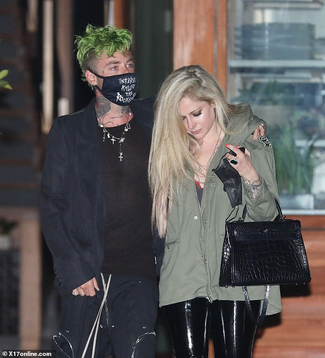 New music: Lavigne has been working with her beau Mod Sun on her upcoming seventh studio album, which is slated to drop in 2021; the couple are pictured in April 2021