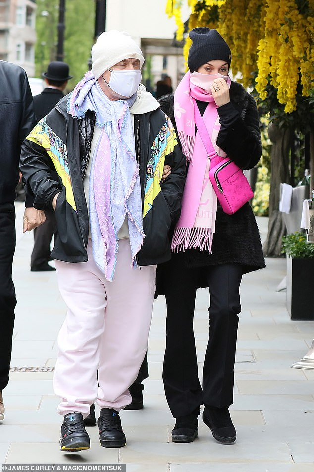 Stepping out: Damien Hirst, 55, and his girlfriend Sophie Cannell, 27, proved they're perfectly in sync as they matched in pink Louis Vuitton scarfs on Sunday