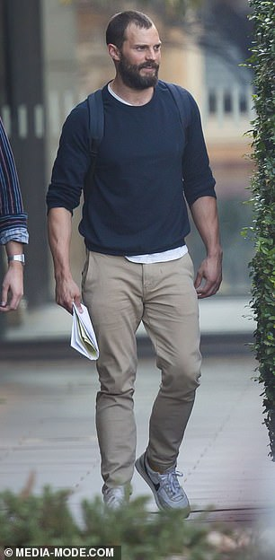 On set: Also on Monday, Jamie flashed a smile as he walked around on set