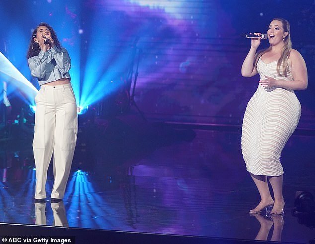 Sharing the spotlight: Kinstler sang a duet of Alessia Cara's song, Scars To You Beautiful, in a white-patterned gown and had her long locks pulled back over her ears