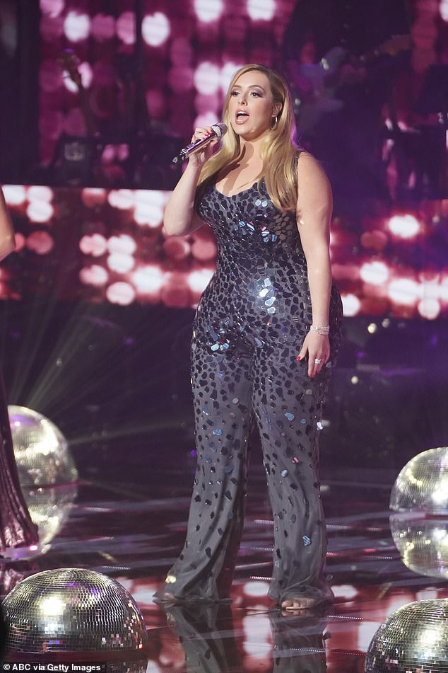 The singer also strutted her stuff in a black sequin jumpsuit