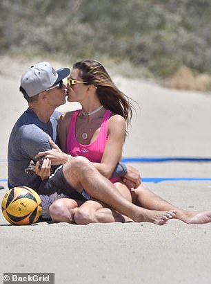 Loved up: Alessandra canoodled with beau Richard Lee during their beach day