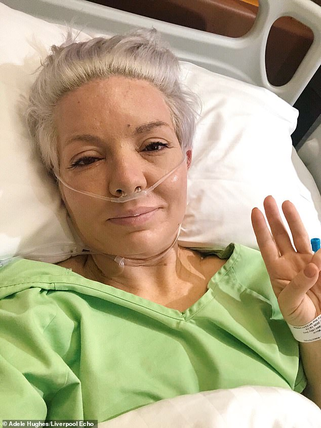 The mother-of-two, pictured in hospital, said she was scared of looking at her own body after parts of her breasts were removed during her treatment, and her bully button was reconstructed