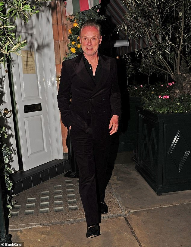 All-black:Gary looked suave in an all-black outfit and teamed his get-up with a luxury pair of Gucci loafers as he left the up-market bar