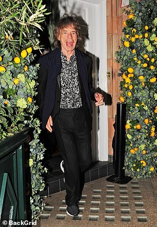 Open wide! Sir Mick put on an animated display as he left Mayfair's popular Harry's Bar ahead of the weekend, flashing photographers his tongue as she he hopped out of the venue