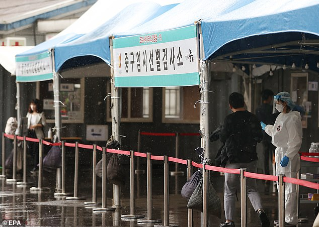 Experts have repeatedly urged ministers to copy South Korea, where mild and asymptomatic cases are quarantined in specialist centres. Pictured: Testing site in South Korea