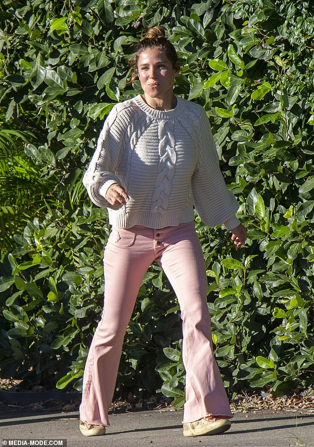 Think pink:The actress, 44, looked very retro indeed, donning a pair of pale pink flares that looked straight out of the 1970s.She teamed the pants with a white jumper in a chunky cable knit, and puffed sleeves, which also had a vintage look