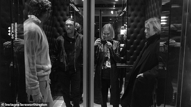 That's rare! Lara Bingle, 33, (second to right) plays budding photographer as she posed for a rare elevator selfie with her husband Sam Worthington on Monday