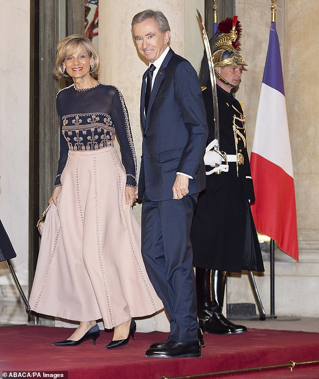 Fashion tycoon Bernard Arnault (pictured with wife Hélène Mercier), 72, has crept ahead of Jeff Bezos to become the world's richest man after his net worth climbed to $186.3billion