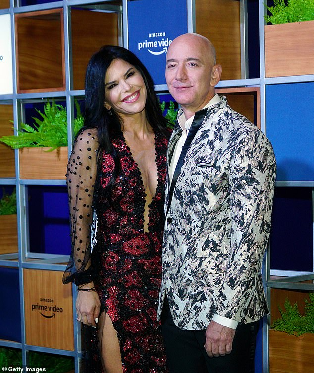 Bezos, 57, (pictured with girlfriend Lauren Sanchez in January 202) who previously held the slot as the world's richest man, was thefirst centibillionaire on the Forbes wealth index