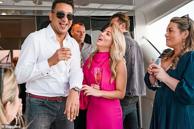 Single and ready to mingle!The senior brand manager, 35, couldn't wipe the smile off her face as she giggled next to her male companionat the boat party hosted by Relier Club