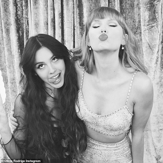 Idol: Olivia's debut album features a sample of Taylor Swift's New year's Day in the song 1 Step Forward, 3 Steps Back (pictured together at the Brit Awards)