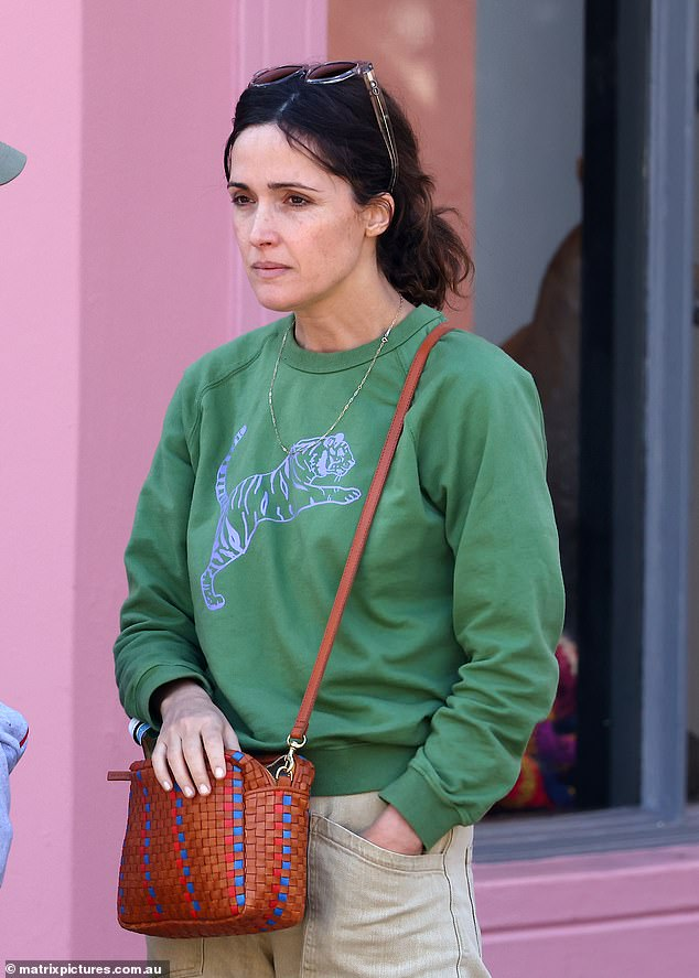 Green with envy:. The actress opted for a casually chic outfit, consisting of a green sweater with a neon purple tiger print
