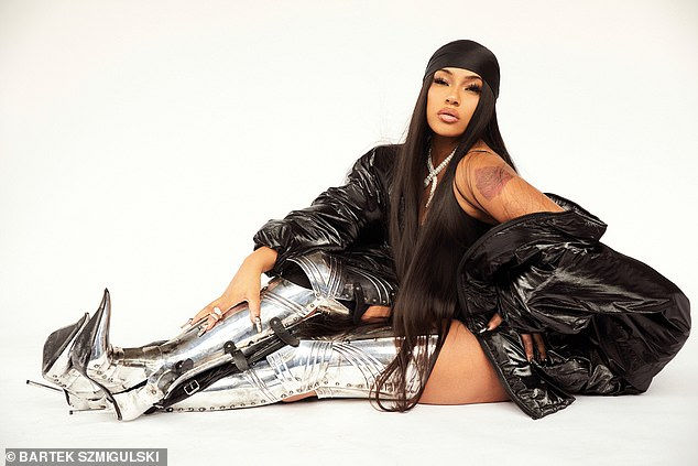 Footwear: Stefflon also wore a pair of thigh-high heels that were made to look like a medieval knight's armour
