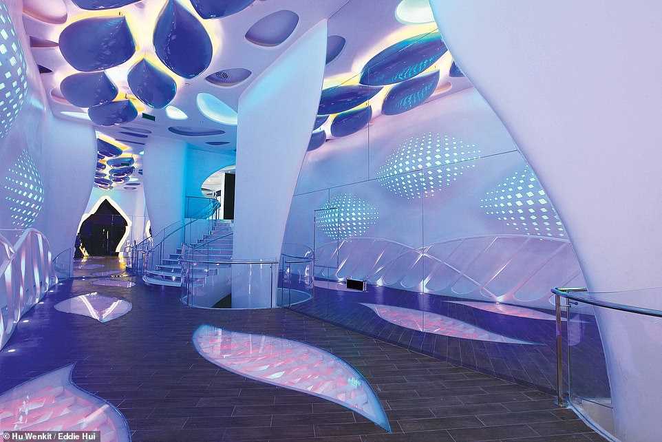 CINEMA FUTURA, ZHONGSHAN, CHINA: This cinema has been dubbed 'the world's first alien cinema'. In the book, Wong explains that its design was inspired byclassic sci-fi movies like Ridley Scott's Alien and James Cameron's Avatar. Pictured is the hallway that movie-goers pass through on their way to the 374-seatChromosome Theatre