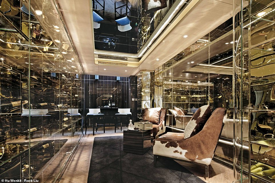 GOLDEN EYE LUXURY HOUSE, JIANGSU, CHINA: This image displays the wine and cigar room in this three-storey, 4,700 sq ft (436 sq m) house. Wong explains that the design was strongly influenced by 'European art house films such as the post-WWII Italy backdrop of Renzo e Luciana, the first episode in Mario Monicelli's 1962 Italian classic Bocaccio '70'