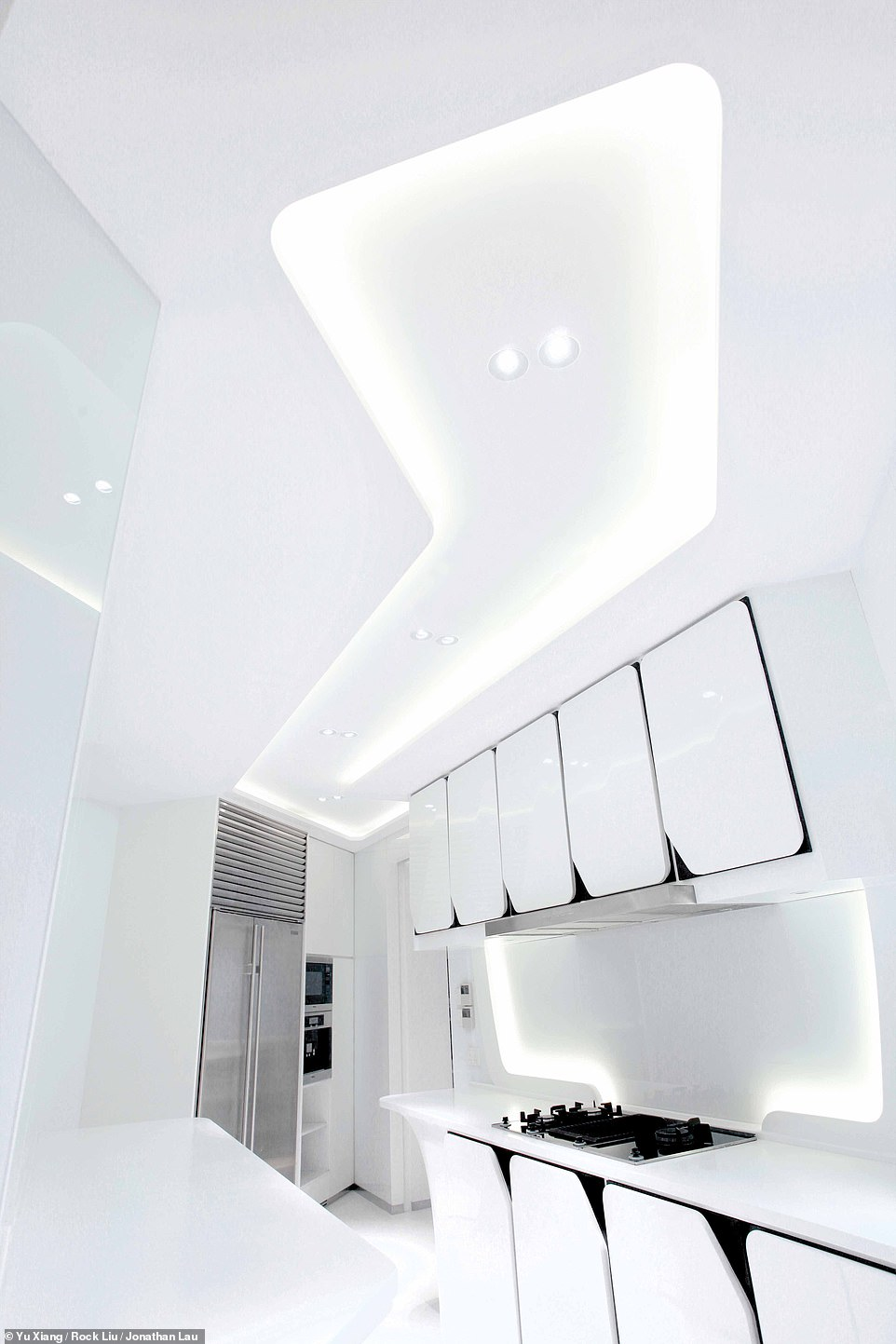 HOUSE OF WHITE APARTMENT, HONG KONG: Wong explains that the result of the design is that 'everywhere it just seems to glow'. He adds: 'It is an amazing space to experience.' Pictured is the sci-fi-style kitchen