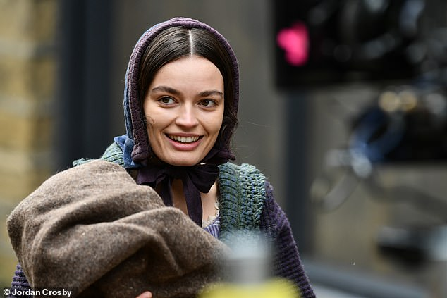 Keeping warm:The actress was also seen with a long brown coat in her arms, which she appeared to keep on hand so she could warm up when cameras weren't rolling