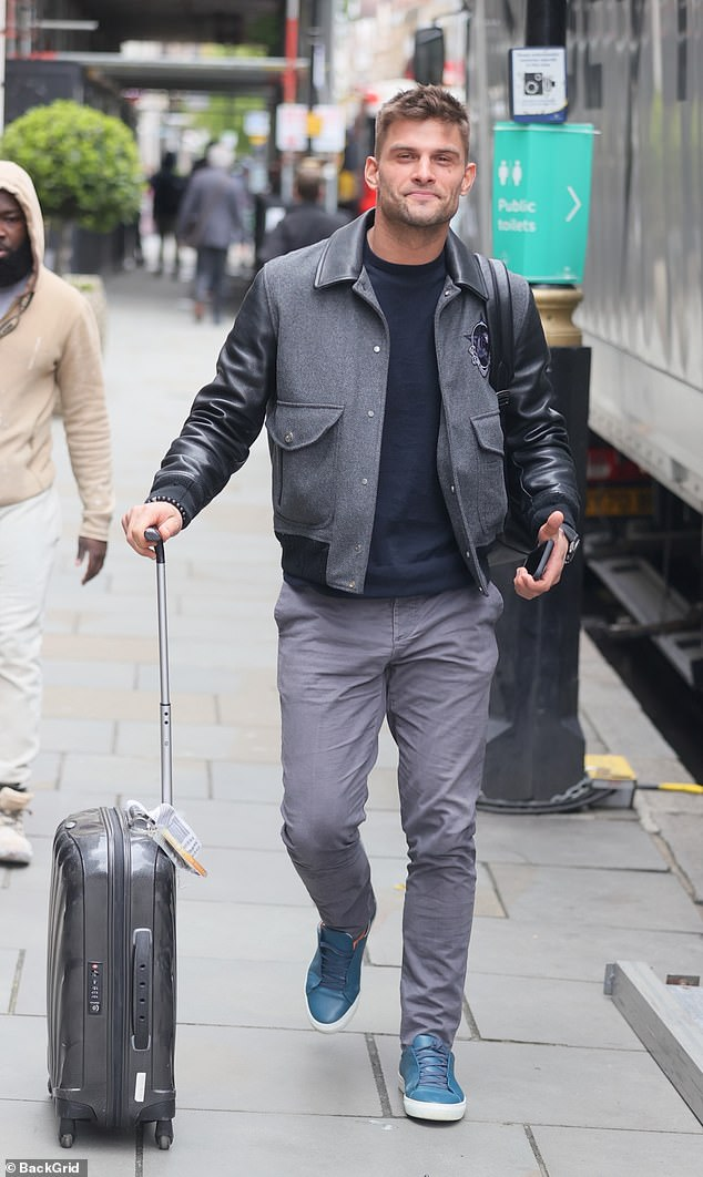 Happy: Earlier in the day, Aljaž, who joined Strictly in 2013, cut a casual figure in an all-grey ensemble as he arrived at the theatre