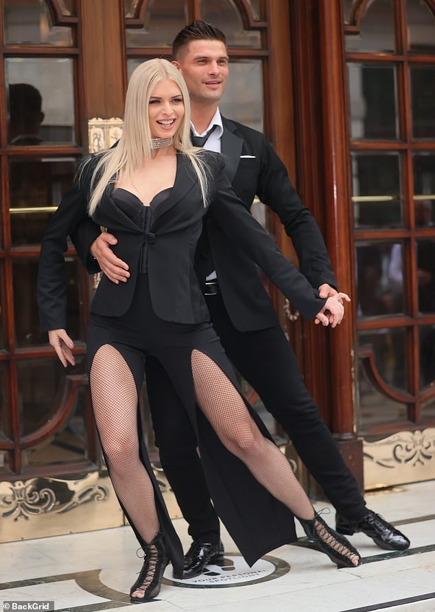 Wow! Strictly Come Dancing proNadia Bychkova made a bold statement in a daring black dress as she joinedAljaž Škorjanec at the London Palladium ahead of Here Come The Boys