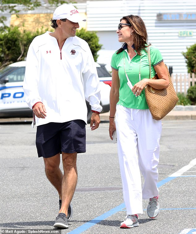 The look of love:She wore a green polo top with white jeans and pink-and-gray New Balance sneakers. On her shoulder was a beige woven purse as she had a mask hanging from her neck