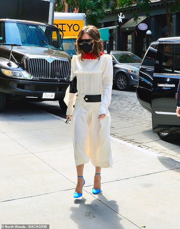 Quirky: The former Spice Girl showed there is little she can't pull off as she left her hotel in the white ensemble which featured frill detail around the shoulders and chest