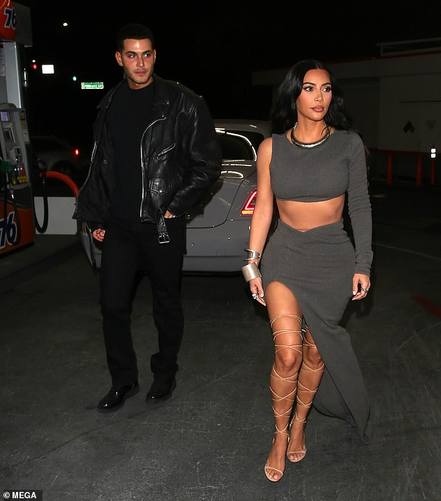 Wow:She filed for divorce from Kanye West in February after nearly seven years of marriage. And on Saturday night, Kim Kardashian made sure to have all attention on her as she arrived to billionaire Jamie Rueben's star studded birthday bash in Beverly Hills; pictured with pal Fai Khadra