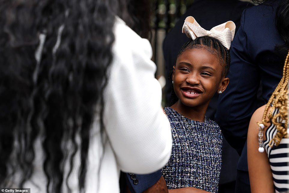 Gianni was transported from the Capitol to the White House on Tuesday. Here she looks up at her mother Roxie Washington, George Floyd's former partner