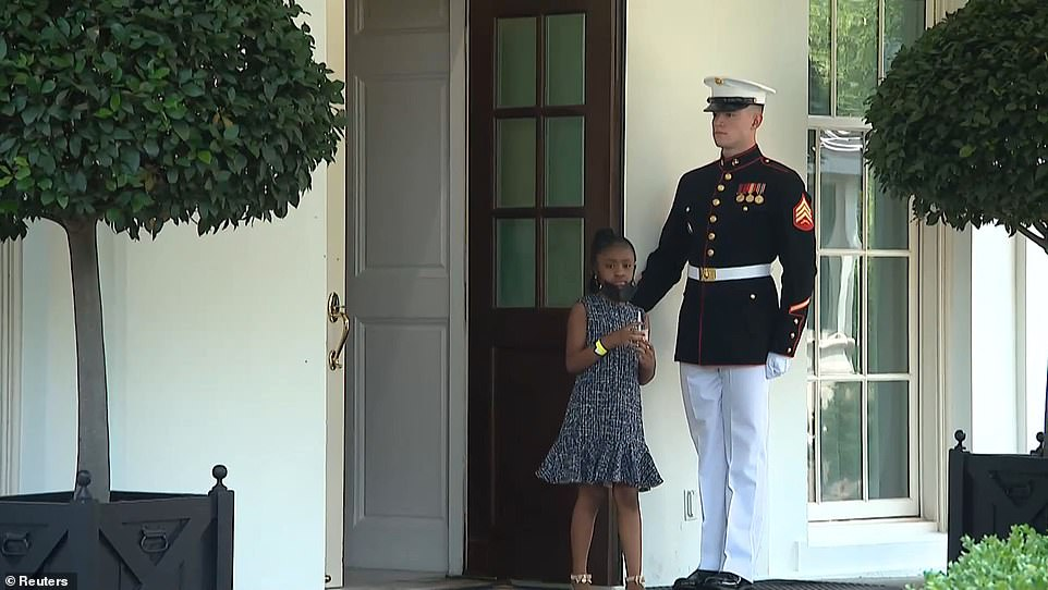 During the Floyd family's meeting with Biden on Tuesday, Gianna emerged shortly from the Oval Office with ice cream in her hand