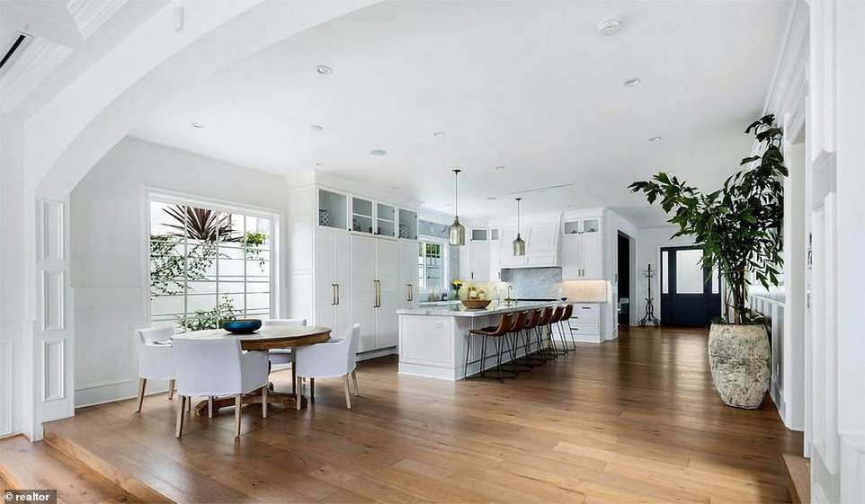 The 3,400-square-foot residence features European hardwood floors, high ceilings and an open plan main area that includes a foyer, kitchen and informal dining area