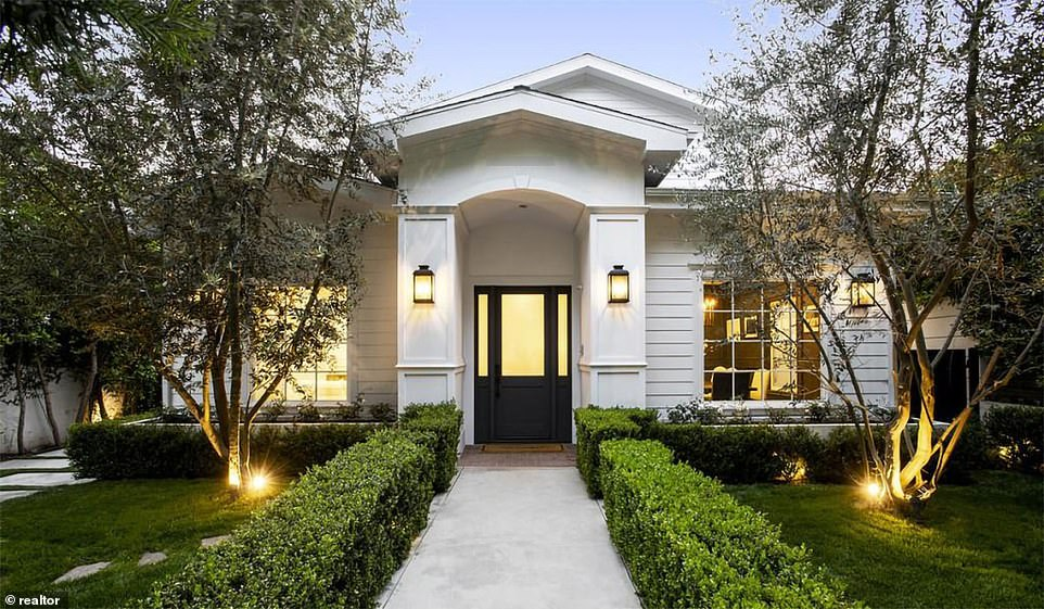Situated behind a high wall and security gates, the two-story residence is secluded and private. It also includes a camera-equipped security system