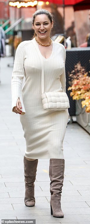 Fashionable: Shedonned a long-sleeved white midi skirt which showcased her enviable curves as she headed home from her shift