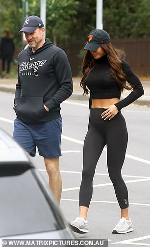 Casual:Nathan wore a black logo sweater, blue workout shorts, black sneakers and a New York cap