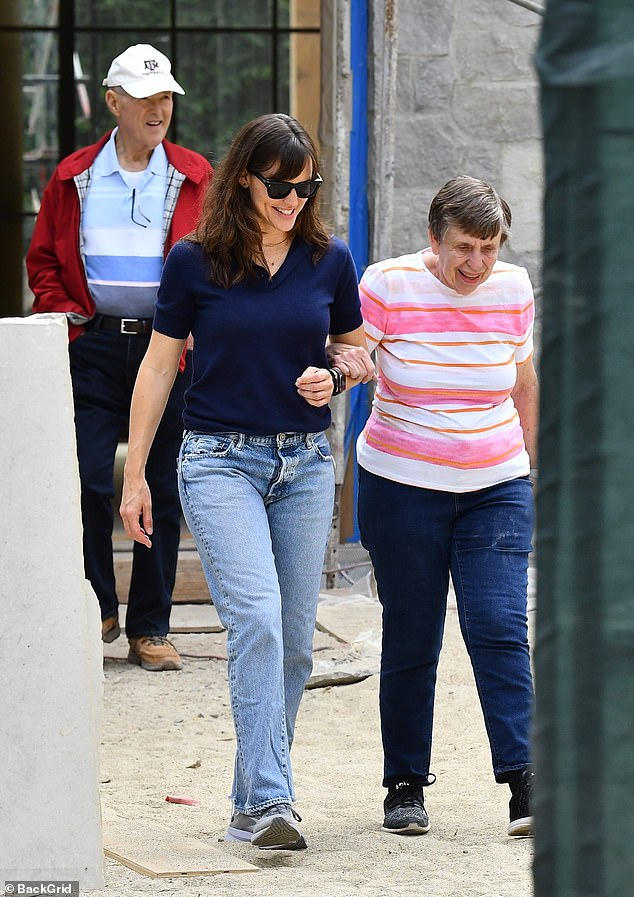Sweet:The 49-year-old actress walked arm-in-arm with her mother Patricia as they explored the Brentwood property