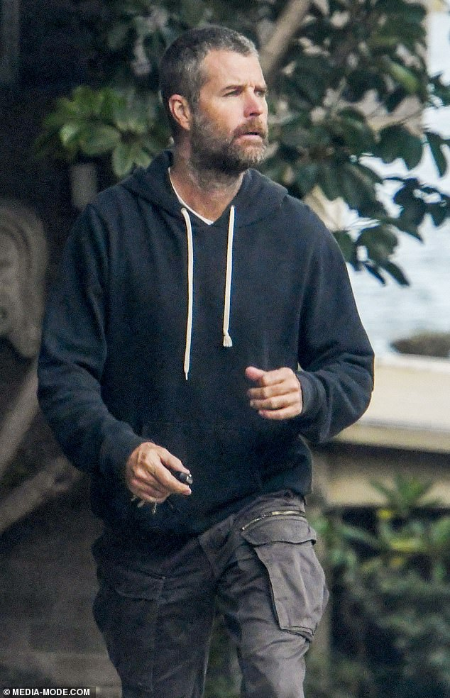 From squeaky to scruffy: The former Channel Seven star, 48, looked dishevelled as he sported a scruffy grey beard and casual clothes while stepping out in Sydney