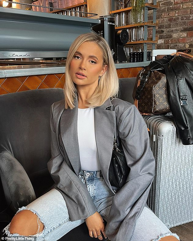 Gorgeous: On Saturday, Molly-Mae also showed off a classic 'blazer and jeans' lookas she posed with designer luggage in a new Instagram post
