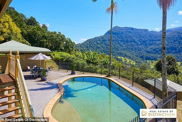 Stunning scenery: The sprawling property sits over 5.26 hectares, and boasts sweeping mountain views, a salt water swimming pool and music shed