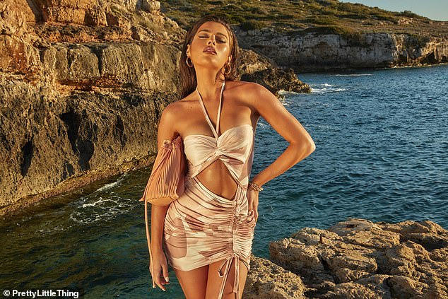 Composed:Tamara subsequently rocked a cut-out dress of the same fabric - which featured a halterneck and drawstring detailing - as she stood in front of the remarkable Majorca coastline